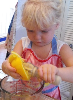 kid help juicer fresh squeezed orange juice