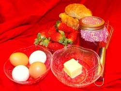 jelly, eggs, butter, croissant, strawberries