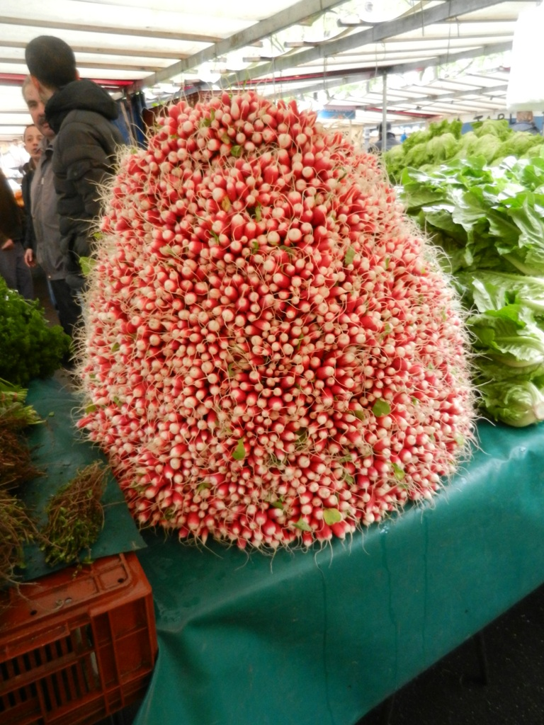 A mountain of fresh radishes at the Market